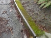 Steel railing on concrete curb