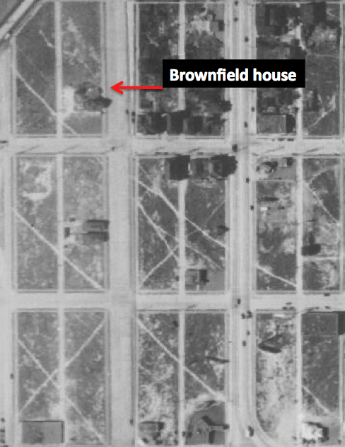 1936 Aerial photo of Denny regrade. By this time a few houses had been built near the Brownfields.